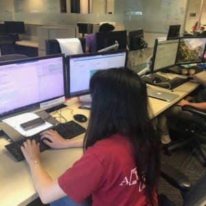 """As an intern, I sit on the ""Intern Island"" with (usually) 6 other interns. I like this space because we get two monitors and a Lenovo Thinkpad."" said Emily Wang"